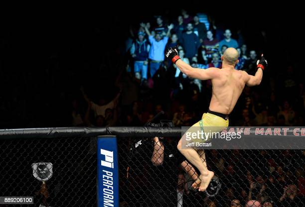 Marlon Moraes of Brazil celebrates his knockout victory over Aljamain Sterling in their bantamweight bout during the UFC Fight Night event inside...