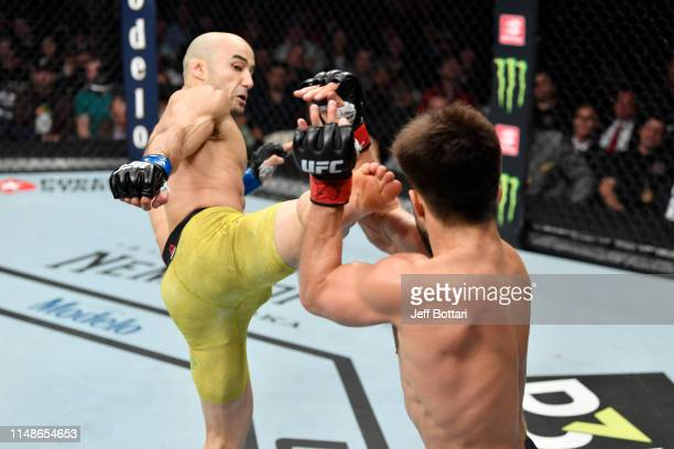 Marlon Moraes of Brazil kicks Henry Cejudo in their bantamweight championship bout during the UFC 238 event at the United Center on June 8 2019 in...