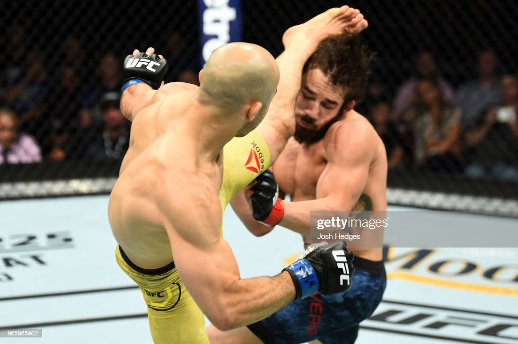 Marlon Moraes of Brazil kicks Jimmie Rivera in the head in their bantamweight fight during the UFC Fight Night event at the Adirondack Bank Center on June 1, 2018 in Utica, New York.