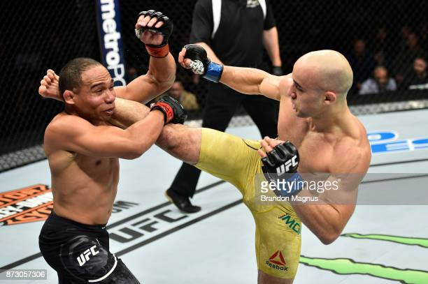 Marlon Moraes of Brazil kicks John Dodson in their bantamweight bout during the UFC Fight Night event inside the Ted Constant Convention Center on...