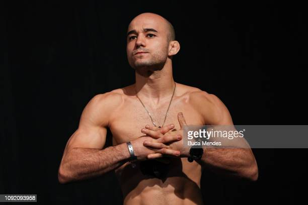 Marlon Moraes of Brazil poses on the scale during the UFC Fight Night Assuncao v Moraes 2 WeighIns at CFO Centro de Formacao Olimpica on February 01...