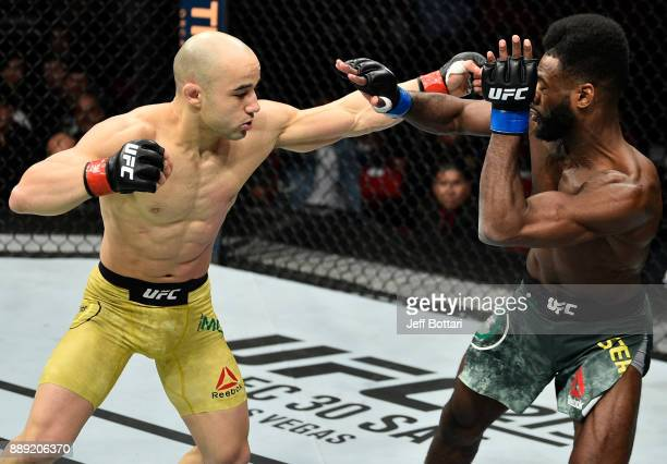 Marlon Moraes of Brazil punches Aljamain Sterling in their bantamweight bout during the UFC Fight Night event inside Save Mart Center on December 9...