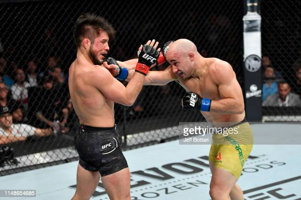 Marlon Moraes of Brazil punches Henry Cejudo in their bantamweight championship bout during the UFC 238 event at the United Center on June 8 2019 in...