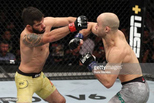 Marlon Moraes of Brazil punches Raphael Assuncao of Brazil in their bantamweight fight during the UFC Fight Night event at CFO Centro de Formacao...