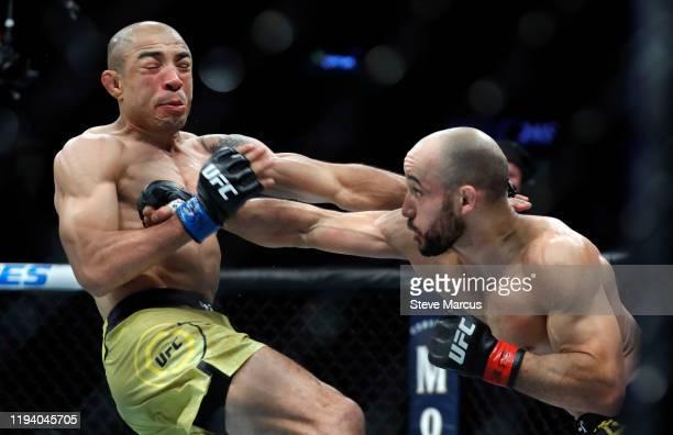 Marlon Moraes punches Jose Aldo in their bantamweight fight during UFC 245 at T-Mobile Arena on December 14, 2019 in Las Vegas, Nevada. Moraes won...