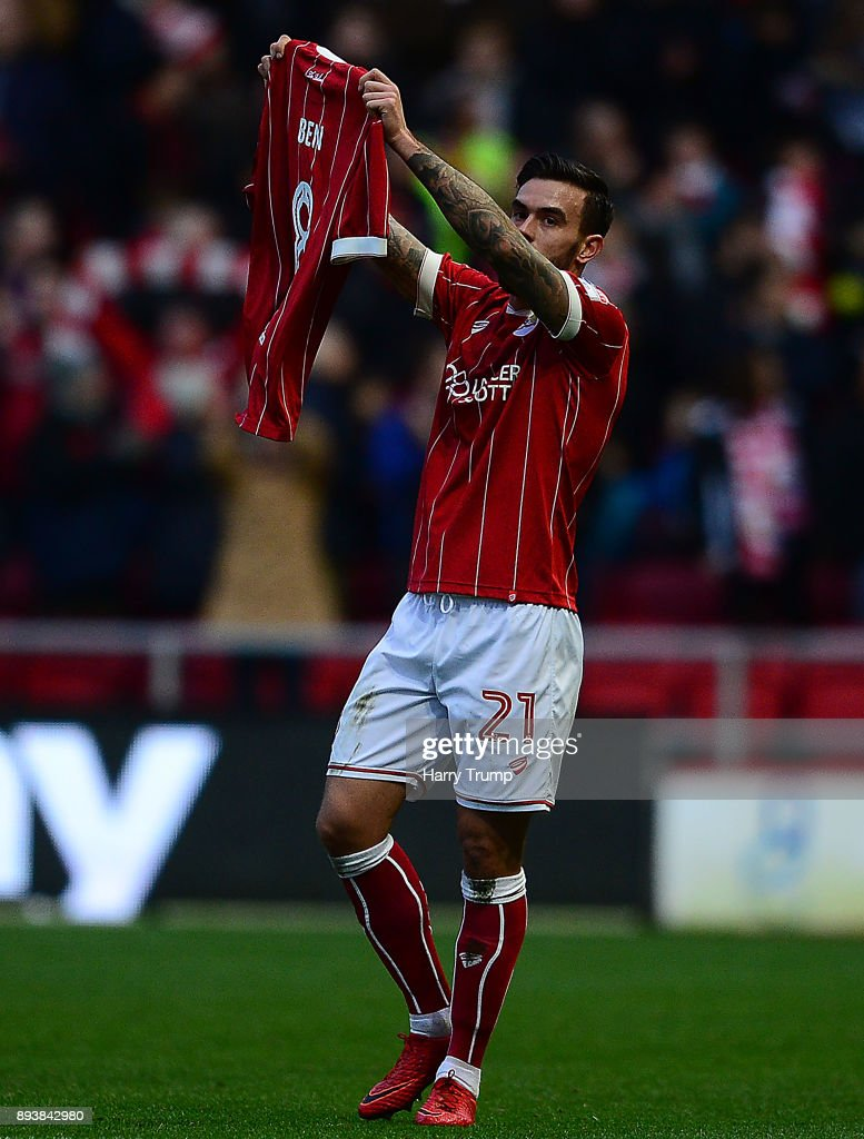 Marlon Pack of Bristol City celebrates after scoring his sides first goal by holding up a Bristol City shirt saying 'Ben 8' in reference to a young Bristol City fan who sadly lost his life aged 8 during the Sky Bet Championship match between Bristol City and Nottingham Forest at Ashton Gate on December 16, 2017 in Bristol, England.