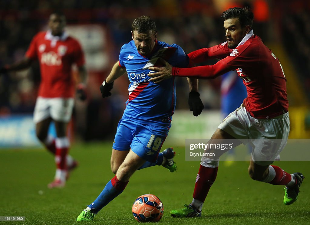Marlon Pack of Bristol City holds back Richie Wellens of Doncaster Rovers during the FA Cup Third Round Replay between Bristol City and Doncaster Rovers at Ashton Gate on January 13, 2015 in Bristol, England.