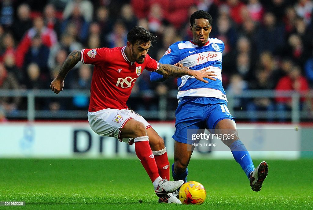 Marlon Pack of Bristol City is tackled by Leroy Fer of Queens Park Rangers during the Sky Bet Championship match between Bristol City and Queens Park Rangers at Ashton Gate on December 19, 2015 in Bristol, England.