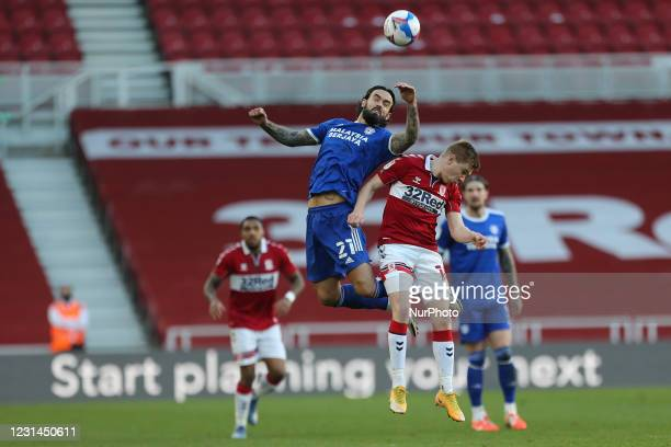 Marlon Pack of Cardiff City contests a header with Duncan Watmore of Middlesbrough during the Sky Bet Championship match between Middlesbrough and...