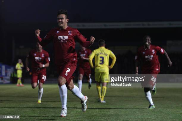 Marlon Pack of Cheltenham Town celebrates scoring his sides second goal during the npower League Two Semi Final Second Leg match between Torquay...