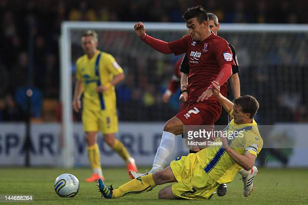 Marlon Pack of Cheltenham Town rides a challenge from Lee Mansell of Torquay United during the npower League Two Semi Final Second Leg match between...