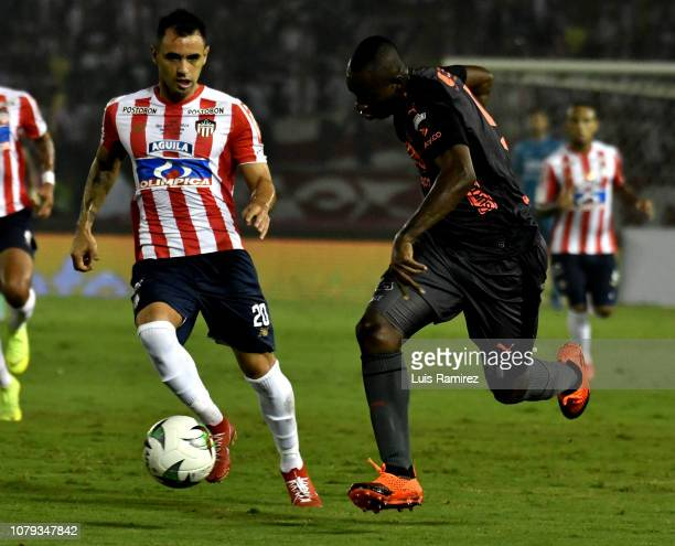 Marlon Piedrahita of Atletico Junior vies for the ball with Juan Fernando Caicedo of Deportivo Independiente Medellin during the first leg final...