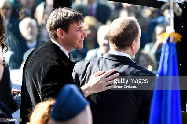 Marlon Reis rubs the back of his partner and newly inaugurated Gov Jared Polis during his inauguration ceremony at the Colorado State Capitol on...