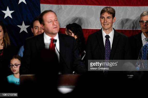 Marlon Reis watches as his partner and newly elected governor of Colorado Jared Polis speaks to supporters during the Democratic watch party in...
