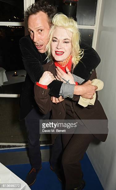 Marlon Richards and Pam Hogg attend Dan Macmillan Daisy Boyd's engagement party at River Cafe on October 9 2016 in London England