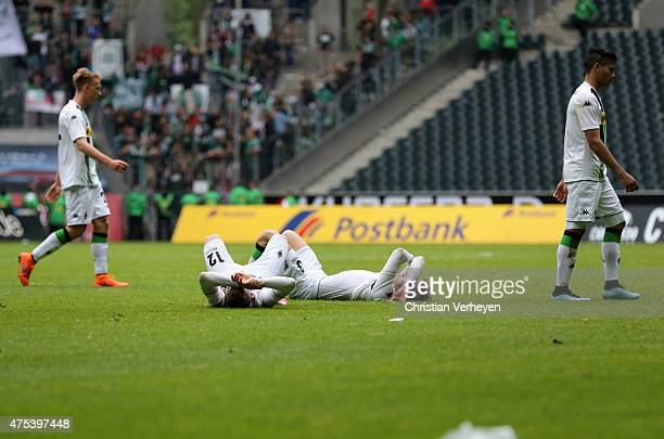 Marlon Ritter and Christopher Lenz of Borussia Moenchengladbach are frustrated on the ground after the 3 Liga Playoffs match between Borussia...