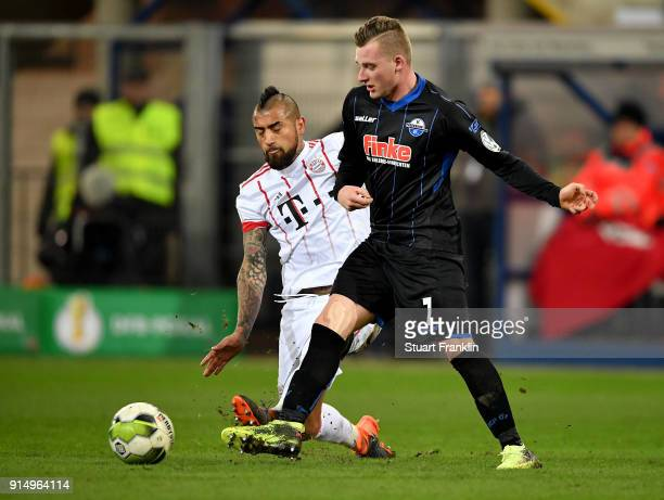 Marlon Ritter of Paderborn and Arturo Vidal of Muenchen battle for the ball during the DFB Cup quarter final match between SC Paderborn and Bayern...