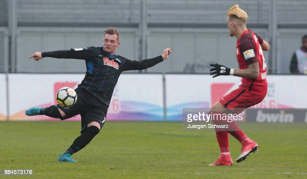 Marlon Ritter of Paderborn and Robert Andrich of Wiesbaden fight for the ball during the 3 Liga match between SV Wehen Wiesbaden and SC Paderborn 07...