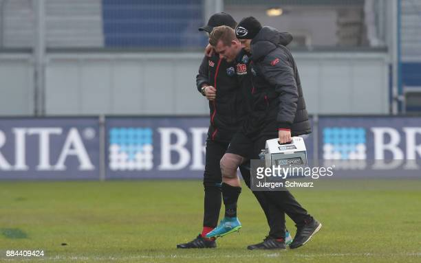 Marlon Ritter of Paderborn is helped off the pitch during the 3 Liga match between SV Wehen Wiesbaden and SC Paderborn 07 at Brita Arena on December...