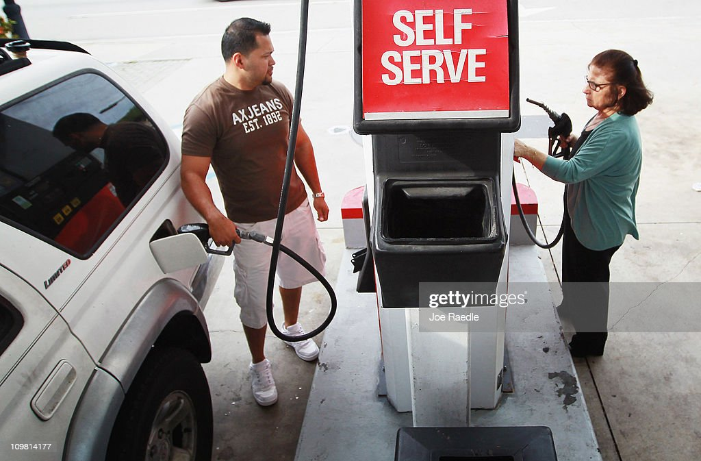 Marlon Roa (L) and Laure (no surname given) pump gas at the Ugas station March 6, 2011 in Miami, Florida. The national average for a gallon of self-serve, regular gas was $3.50 a .33 cent increase from two weeks ago. This was the second largest two-week jump in gas prices ever, largely due to the events unfolding in Libya.