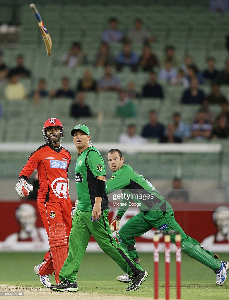 Marlon Samuels (L) of the Melbourne Renegades throws his bat in front of Shane Warne of the Melbourne Stars in a heated exchange with during the Big Bash League match between the Melbourne Stars and the Melbourne Renegades at Melbourne Cricket Ground on January 6, 2013 in Melbourne, Australia.