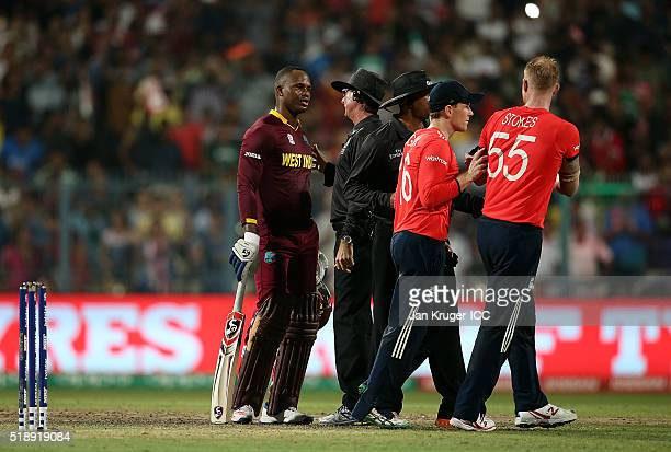 Marlon Samuels of the West Indies argues with Ben Stokes of England during the ICC World Twenty20 India 2016 final match between England and West...