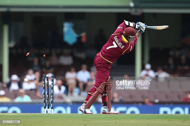 Marlon Samuels of the West Indies bowled by England's Steven Finn at the Sydney Cricket Ground. Sydney Australia. Monday, 9th February 2015 .