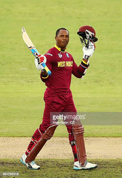 Marlon Samuels of the West Indies celebrates and acknowledges the crowd after scoring a century during the 2015 ICC Cricket World Cup match between...