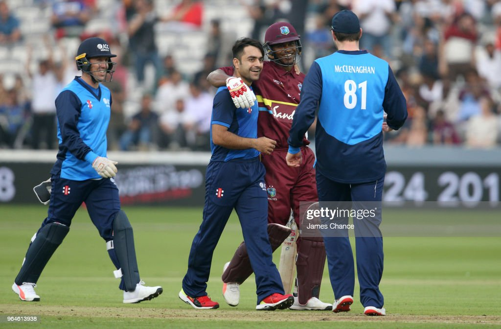 Marlon Samuels of the West Indies speaks to Rashid Khan of the ICC World XI and Mitchell McClenaghan of the ICC World XI during the Hurricane Relief T20 match between the ICC World XI and West Indies at Lord's Cricket Ground on May 31, 2018 in London, England.