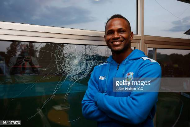 Marlon Samuels of The West Indies stands next to a window he broke during The Cricket World Cup Qualifier between The West Indies and Zimbabwe at The...