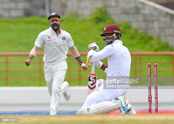 Marlon Samuels of West Indies bowled by Ishant Sharma of India as India captain Virat Kohli celebrates during the 5th and final day of the 3rd Test...