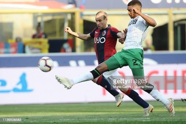 Marlon Santos of US Sassuolo competes the ball with Rodrigo Palacio of Bologna FC during the Serie A match between Bologna FC and US Sassuolo at...