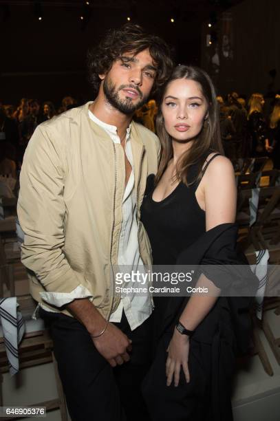 Marlon Teixeira and MarieAnge Casta attend the HM Studio show as part of the Paris Fashion Week on March 1 2017 in Paris France