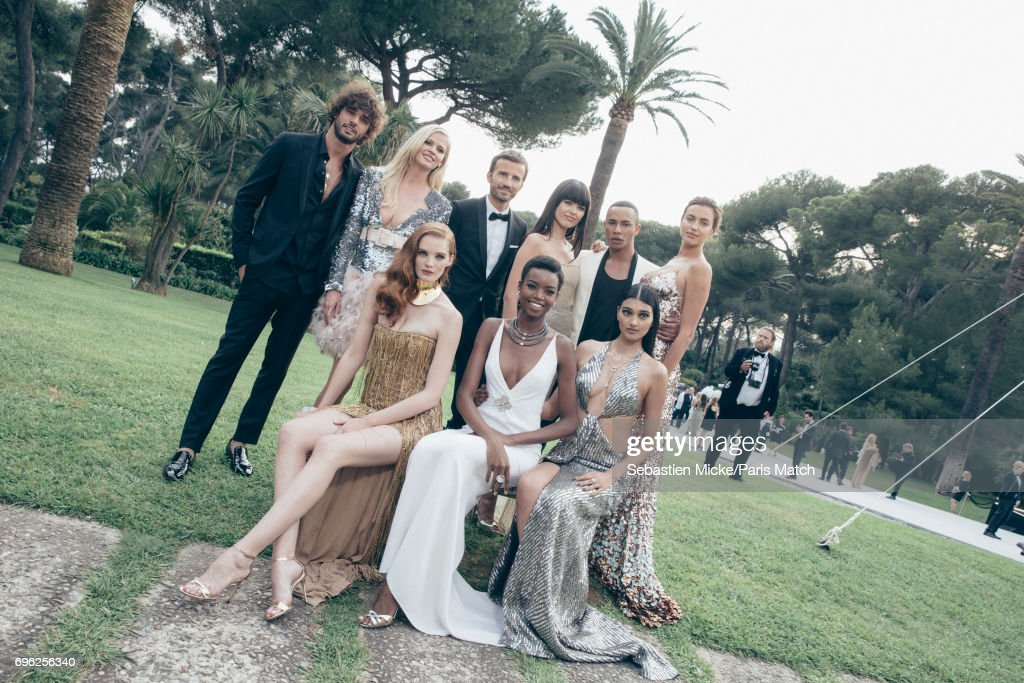 Marlon Texeira, Lara Stone, Pierre Emmanuel Angeloglou, Kristina Bazan, Olivier Rousteing, Irina Shayk, Alexina Graham, Maria Borges, Neelam Gill are photographed for Paris Match whilst attending the Amfar Gala at the Eden Roc Hotel on May 25, 2017 in Antibes, France.