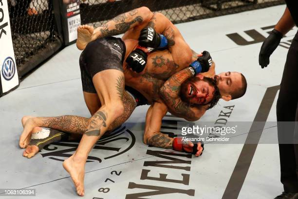 Marlon Vera of Ecuador attempts to submit Guido Cannetti of Argentina in their bantamweight bout during the UFC Fight Night event inside Arena Parque...