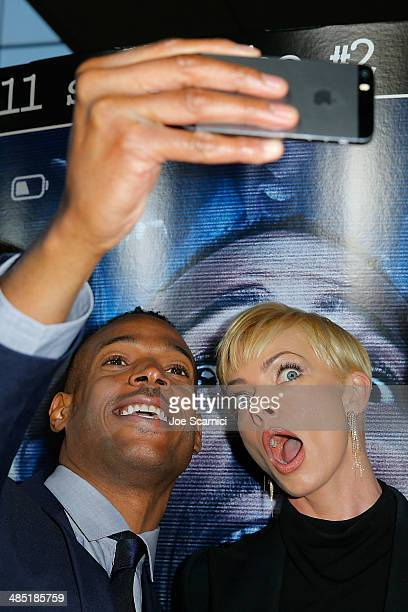 Marlon Wayans and Jaime Pressly take a selfie at the 'A Haunted House 2' Los Angeles Premiere Red Carpet at Regal Cinemas LA Live on April 16 2014 in...