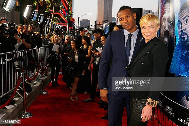 Marlon Wayans and Jaime Pressly walk the 'A Haunted House 2' Los Angeles Premiere Red Carpet at Regal Cinemas LA Live on April 16 2014 in Los Angeles...