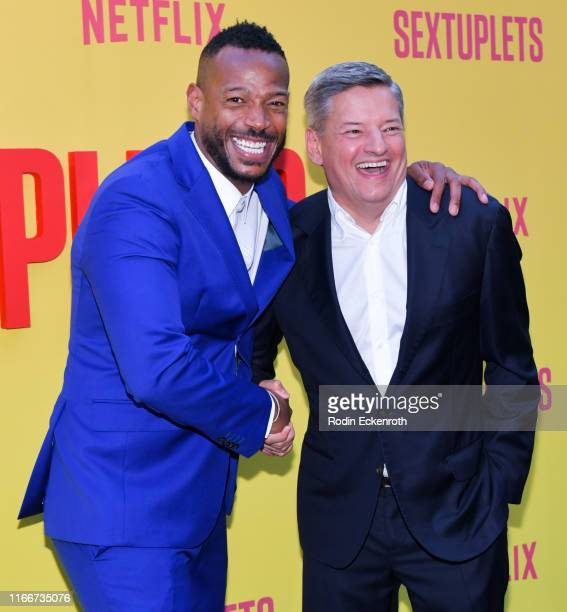 Marlon Wayans and Netflix chief content officer Ted Sarandos attend the premiere of Netflix's Sextuplets at ArcLight Hollywood on August 07 2019 in...
