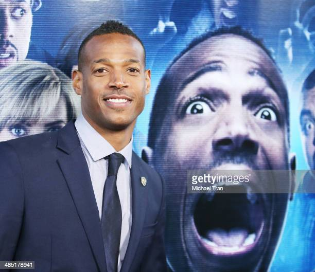 Marlon Wayans arrives at the Los Angeles premiere of 'A Haunted House 2' held at Regal Cinemas LA Live on April 16 2014 in Los Angeles California