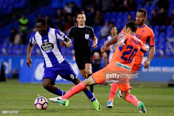 Marlos Moreno forward of Deportivo de La Coruña battles for the ball with Matthieu Saunier defender of Granada CF during the La Liga Santander match...