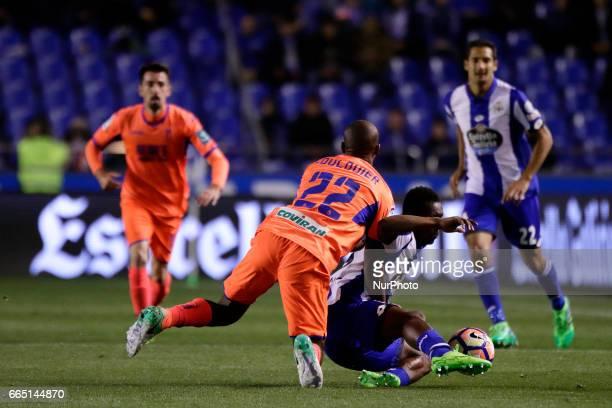 Marlos Moreno forward of Deportivo de La Coruña battles for the ball with Dimitri Foulquier defender of Granada CF during the La Liga Santander match...