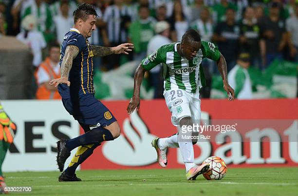 Marlos Moreno of Atletico Nacional and Pablo Alvarez of Rosario Central fight for the ball during a second leg match between Atletico Nacional and...
