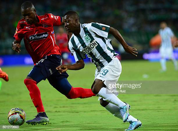 Marlos Moreno of Atletico Nacional struggles for the ball with Andres Mosquera of Independiente Medellin during a second leg match between Atletico...