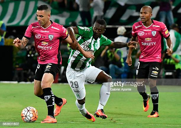Marlos Moreno of Atletico Nacional vies for the ball with Christian Nuñez of Independiente del Valle during a second leg final match between Atletico...