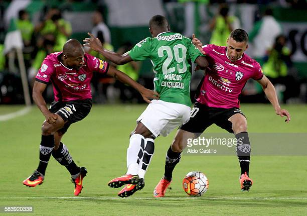 Marlos Moreno of Atletico Nacional vies for the ball with Jose Angulo and Julio Angulo of Independiente del Valle during a second leg final match...