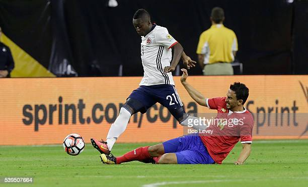Marlos Moreno of Colombia attempts to avoid a sliding tackle by Randall Azofeifa of Costa Rica in the second half at NRG Stadium on June 11, 2016 in...