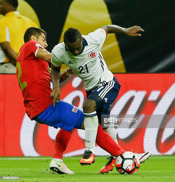 Marlos Moreno of Colombia attempts to go around Johnny Acosta of Costa Rica at NRG Stadium on June 11 2016 in Houston Texas