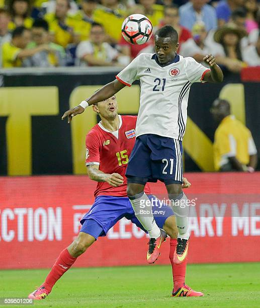 Marlos Moreno of Colombia heads th4 ball away from Jose Salvatierra of Costa Rica in the first half at NRG Stadium on June 11 2016 in Houston Texas
