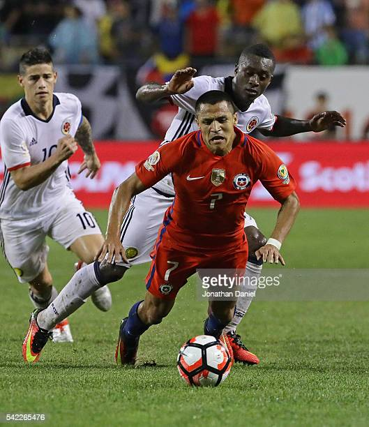 Marlos Moreno of Colombia takes down Alexis Sanchez of Chile during a semifinal match in the 2016 Copa America Centernario at Soldier Field on June...