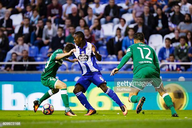 Marlos Moreno Omar Ramos and Carl Medjani in action during the Spanish league football match between Real Club Deportivo de La Coruña vs Club...